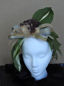 "Design Botanical Arts, Artistic Craft Monica Taylor ""Derby Day"" A fascinator hat made from sinamay ribbon, decorated with hosta leaves, woodland fern leaves and sedum ""Purple Emporor"""